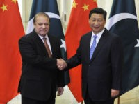 "FILE - In this Nov. 8, 2014 file-pool photo, Pakistani Prime Minister Nawaz Sharif, left, and Chinese President Xi Jinping shake hands before their meeting at the Great Hall of the People in Beijing, China. Pakistani leaders often wax lyrical about their ""sweeter than honey"" relations with all-weather friend China. …"