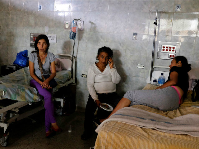 Patients lie on beds at the Universitary Hospital in Merida, Venezuela June 17, 2016. REUTERS/Marco Bello