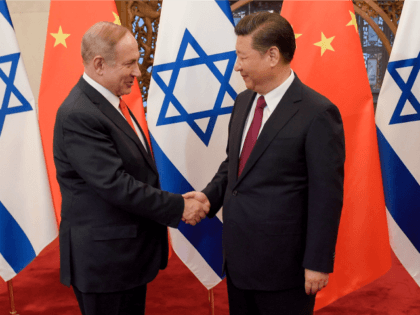Israeli Prime Minister Benjamin Netanyahu, left, is greeted by Chinese President Xi Jinping ahead of their talks at Diaoyutai State Guesthouse Tuesday, March 21, 2017 in Beijing, China. (Etienne Oliveau/Pool Photo via AP)
