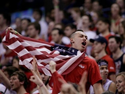 A fan in the Gonzaga student section wears an American flag before an NCAA college basketball game against BYU in Spokane, Wash., Saturday, Feb. 25, 2017. (AP Photo/Young Kwak)