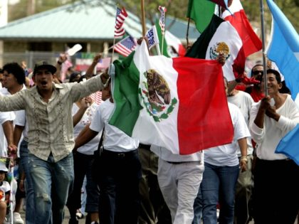 Protestors wave American, Mexican and Guatemalan flags as thousands march at an immigration rally in Homestead, Fla. as part of a planned national day of economic protests, boycotting work, school and shopping to show the importance on immigrants to the country Monday, May 1, 2006. (AP Photo/Lynne Sladky)