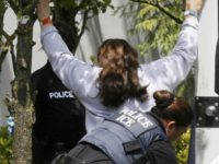 A policewoman is shown searching a woman outside of the Fresh Del Monte Produce fruit and vegetable processing plant on June 12, 2007, in Portland, Ore. Fictitious Social Security numbers and green cards are cheap and widely available, and getting them is the first step for many undocumented immigrants arriving …