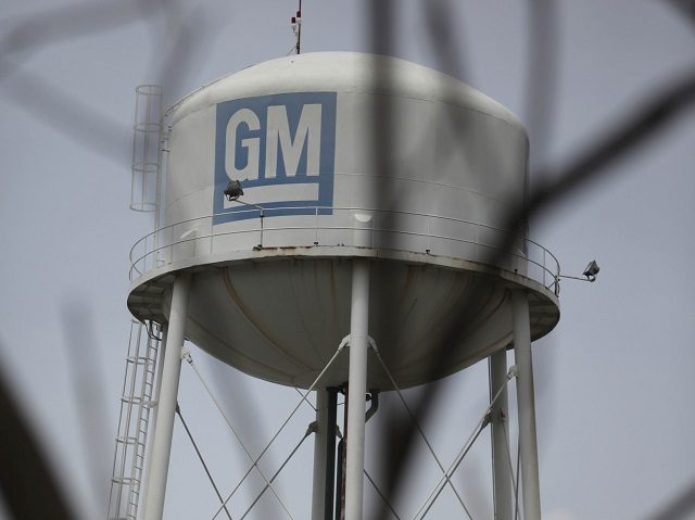 General Motors Corp. initials are seen inside of the company's compound in Valencia, Venezuela, Wednesday, June 17, 2009. General Motors Corp. is halting production in Venezuela for three months starting Friday because the government won't give them enough dollars to import parts. (AP Photo/Ariana Cubillos)
