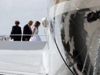 Barron Trump, 11, let, President Donald Trump and first lady Melania Trump board Air Force One as they depart Palm Beach International Airport, Sunday, April 16, 2017, in West Palm Beach, Fla. (AP Photo/Alex Brandon)