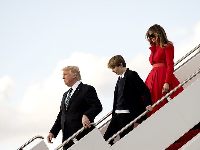 President Donald Trump, with his wife first lady Melania Trump and their son Barron Trump, disembark from Air Force One upon arrival at Palm Beach International Airport in West Palm Beach, Fla., Friday, March 17, 2017. (AP Photo/Manuel Balce Ceneta)