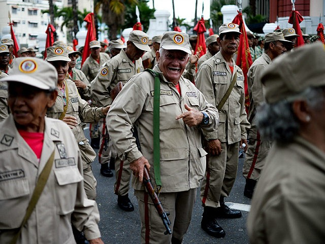 Members of the Bolivarian Militia take part in a parade in the framework of the seventh anniversary of the force, in front of the Miraflores presidential palace in Caracas on April 17, 2017. Venezuela's defence minister on Monday declared the army's loyalty to Maduro, who ordered troops into the streets …