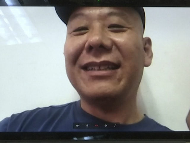 FILE - In this Monday, April 17, 2017, file photo, Chinese dissident Zhang Xiangzhong is seen on a computer screen during an interview via videoconference in Taipei, Taiwan. Taiwan's return Zhang this week is seen by analysts as a possible bid by President Tsai Ing-wen to stabilize relations with Beijing. …