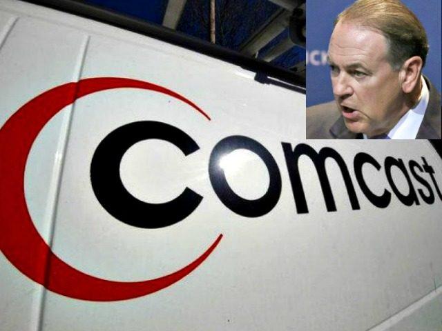Comcast-Huckabee AP Photos