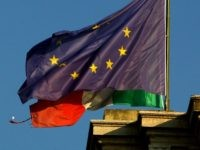 MILAN, ITALY - NOVEMBER 17: The flags of Italy and the European Union are displayed on November 17, 2011 in Milan, Italy. Italy's new Prime Minister Mario Monti unveiled the country's new government yesterday, November 16, as the country steps up efforts to avoid being dragged further into the euro …