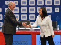 "Peruvian presidential candidate for the Fuerza Popular (Popular Strength) party Keiko Fujimori (R) shakes hands with Peruvian presidential candidate Pedro Pablo Kuczynski of the ""Peruanos por el Kambio"" (Peruvians for change) party before a televised debate in Lima on May 29, 2016. Fujimori and Kuczynski will compete in Peru's June …"