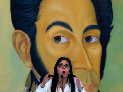 """Venezuelan Foreign Minister Delcy Rodriguez speaks during a press conference in Caracas on March 29, 2017. Rodriguez accused on Wednesday the government of the United States of putting pressure on other OAS members to execute an """"interventionist plan"""" in her country. / AFP PHOTO / JUAN BARRETO (Photo credit should …"""