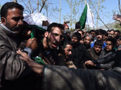 Indian Kashmiri villagers shout pro-independence slogans as they carry a body of a youth Umar Farooq at his funeral in Baroosa, in central Kashmirs Ganderbal district, on April 10, 2017. Eight civilians were killed in Indian-administered Kashmir on April 9 when police opened fire at protesters who stormed polling stations …