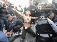Femen Activists Protest As Le Pen Casts Ballot