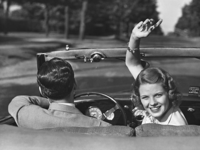 UNITED STATES - CIRCA 1950s: Couple driving in convertible. (Photo by George Marks/Retrofile/Getty Images)