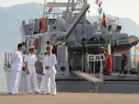 Libyan naval officers stand in front of