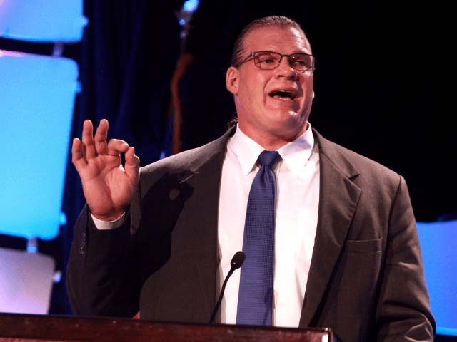 """Glenn Jacobs, also known as """"Kane"""", speaking at the 2013 Liberty Political Action Conference (LPAC) in Chantilly, Virginia."""