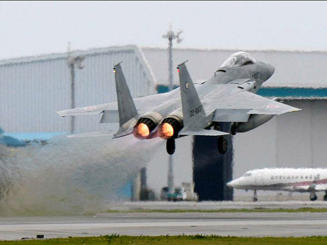 A Japanese Air Self Defense Force F-15 fighter scrambles at the Air Self Defense Force Naha base in Naha, Okinawa prefecture, Japan, in this photo taken by Kyodo April 13, 2015. Mandatory credit Kyodo/via REUTERS