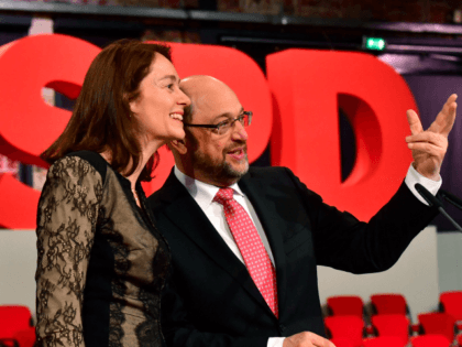 Former European parliament president and candidate for Chancellor of Germany's social democratic (SPD) party Martin Schulz (R) and Secretary General of the SPD Katarina Barley tour the Arena Berlin, one day ahead of the party congress on March 18, 2017 in Berlin.