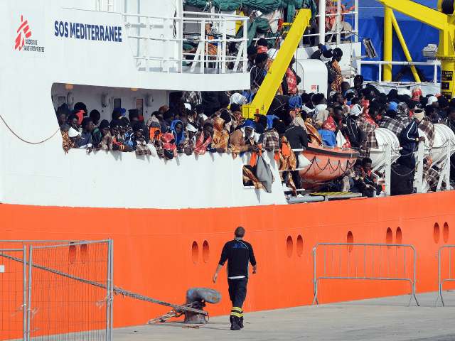 Would be immigrants wait to disembark in the port of Catania, on the island of Sicily on March 21, 2017 from the ship 'Aquarius' following a rescue operation in the Mediterranean sea, where some 946 would be immigrants have been rescued.
