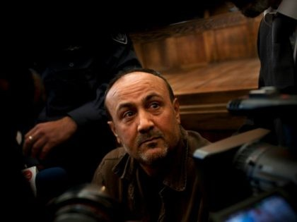 In this Jan. 25, 2012 file photo, jailed Senior Fatah leader Marwan Barghouti appears in a Jerusalem court. Qadoura Fares, an advocate for prisoners' rights, said Monday, April 17, 2027, that more than 1,500 Palestinian prisoners have launched an open-ended hunger strike to demand better conditions in Israeli prisons, including …