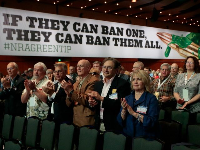 People applaud a speaker at the National Rifle Association convention Friday, April 10, 2015, in Nashville, Tenn. (AP Photo/Mark Humphrey)