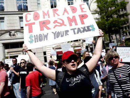 Obama girl Trump tax returns (Aaron P. Bernstein / Getty)