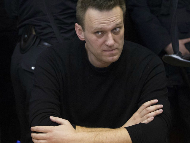 Russian opposition leader Alexei Navalny sits in court in Moscow, Russia, Thursday, March 30, 2017. Many Western countries have condemned the arrests and called for the release of those sentenced to jail, including opposition leader Alexei Navalny, Putin's most prominent foe. (AP Photo/Pavel Golovkin)