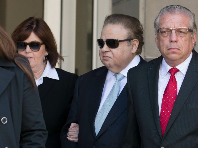 Salomon Melgen, second from right, leaves federal court, Thursday, April 2, 2015, in Newark, N.J. Melgen and U.S. Sen. Bob Menendez, the top Democrat on the U.S. Senate Foreign Relations Committee, were indicted Wednesday on corruption charges. A federal grand jury indictment accuses Menendez of using the power of his …