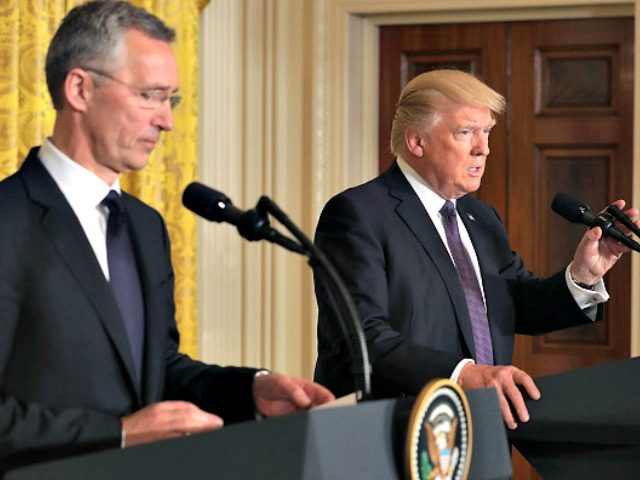 """WASHINGTON, DC - APRIL 12: NATO Secretary General Jens Stoltenberg (L) and U.S. President Donald Trump hold a news conference in the East Room of the White House April 12, 2017 in Washington, DC. Trump reaffired the United States' commitment to the North Atlantic alliance and its """"ironclad"""" pledge to …"""