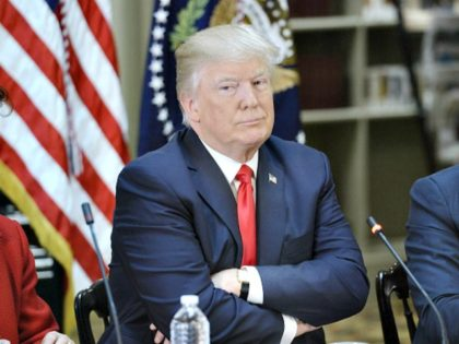 Trump arms crossed Oliver DoulieryGetty