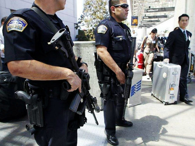 Los Angeles Airport Police officers stand in front of the Tom Bradley International Terminal at LAX airport in Los Angeles May 2, 2011. REUTERS/Danny Moloshok
