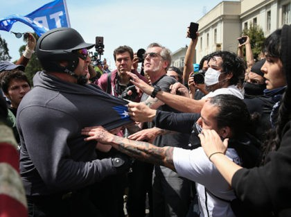 "BERKELEY, CA - APRIL 15: Trump supporters clash with protesters at a ""Patriots Day"" free speech rally on April 15, 2017 in Berkeley, California. More than a dozen people were arrested after fistfights broke out at a park where supporters and opponents of President Trump had gathered. (Photo by Elijah …"