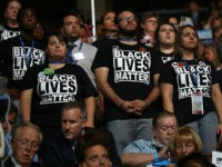 PHILADELPHIA, PA - JULY 26: Supporters of the Black Lives Matter movement stand during remarks from the Mothers of the Movement on the second day of the Democratic National Convention at the Wells Fargo Center, July 26, 2016 in Philadelphia, Pennsylvania. Democratic presidential candidate Hillary Clinton received the number of votes needed to secure the party's nomination. An estimated 50,000 people are expected in Philadelphia, including hundreds of protesters and members of the media. The four-day Democratic National Convention kicked off July 25. (Photo by Joe Raedle/Getty Images)
