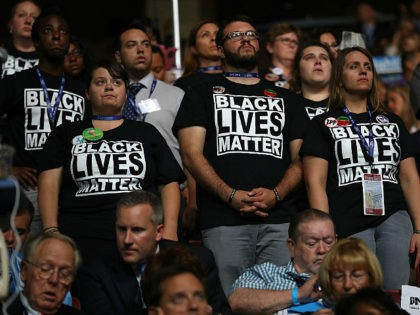 PHILADELPHIA, PA - JULY 26: Supporters of the Black Lives Matter movement stand during remarks from the Mothers of the Movement on the second day of the Democratic National Convention at the Wells Fargo Center, July 26, 2016 in Philadelphia, Pennsylvania. Democratic presidential candidate Hillary Clinton received the number of …