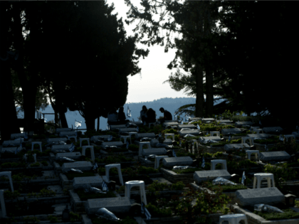 Israelis visits the graves of fallen soldiers on the eve of memorial Day at the military cemetery in Mount Hertzl in Jerusalem, Tuesday, May 10, 2016. Israel will mark the annual Memorial Day in remembrance of soldiers who died in the nation's conflicts, beginning at dusk Tuesday until Wednesday evening. …