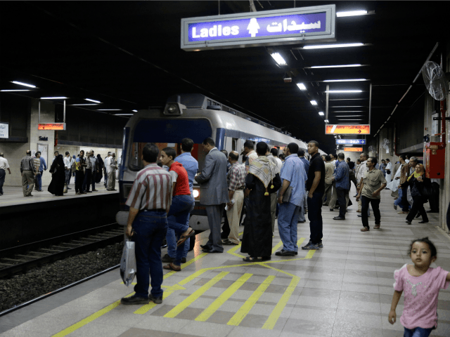 Passengers prepare to embark an arriving train at the Sadat metro station located beneath Tahrir Square, in Cairo, Egypt, Wednesday, June 17, 2015. Sadat station, one of Cairo's largest, re-opened after nearly two years of closure for security reasons. The sprawling underground station is one of only two stations where …