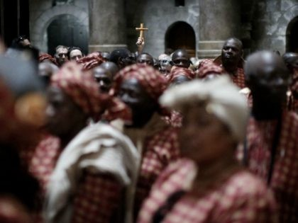 Nigerian pilgrims wait outside the Tomb of Jesus during their visit at the Holy Sepulchre in Jerusalem's Old City on February 25, 2016. / AFP / THOMAS COEX (Photo credit should read THOMAS COEX/AFP/Getty Images)