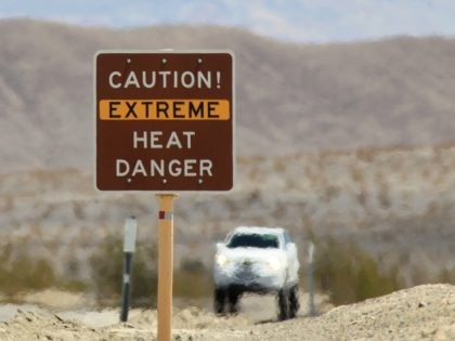 DEATH VALLEY NATIONAL PARK, CA JULY 14: Heat waves rise near a heat danger warning sign on the eve of the AdventurCORPS Badwater 135 ultra-marathon race on July 14, 2013 in Death Valley National Park, California. Billed as the toughest footrace in the world, the 36th annual Badwater 135 starts …