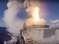 In this photo taken on Tuesday, Nov. 15, 2016 and made from the footage taken from Russian Defense Ministry official web site the Russian Navy frigate Admiral Grigorovich launches a Kalibr cruise missile at a target in Syria from the eastern Mediterranean Sea. The Russian military launched a series of …
