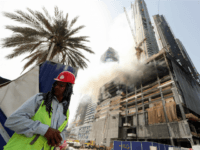 Smoke billows from the scene of a fire which broke out in a construction site near the Dubai Mall and Burj Khalifa, the world's tallest building, and burned for several hours in Dubai on April 2, 2017. A blaze erupted in a residential complex under construction near Dubai's biggest shopping …