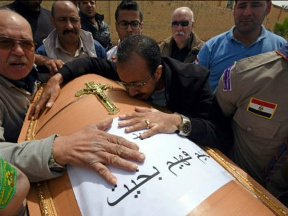 Men mourn over the coffin of one of the victims of the blast at the Coptic Christian Saint Mark's church in Alexandria the previous day during a funeral procession at the Monastery of Marmina in the city of Borg El-Arab, east of Alexandria on April 10, 2017. Egypt prepared to …