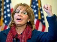 In this March 4, 2015 file photo, former U.S. Rep. Gabby Giffords, D-Ariz., speaks on Capitol Hill in Washington about bipartisan legislation on gun safety. The gun safety group founded by former congresswoman Giffords has recruited an unlikely ally: a group of former high-level military officials. The political action committee …