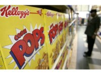 Leon Remus shops for cereal at the Indian Village Market in Detroit, Wednesday, July 27, 2005. Kellogg Co., the nation's largest breakfast-cereal maker, said Wednesday that second-quarter earnings rose 9 percent and the company raised profit guidance for the full year. (AP Photo/Paul Sancya)