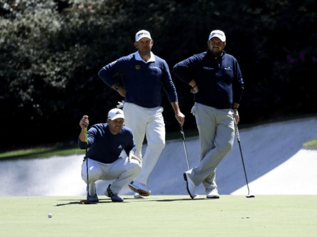 (L-R) Sergio Garcia of Spain, Lee Westwood of England and Shane Lowry of Ireland wait on a green during the second round of the 2017 Masters Tournament at Augusta National Golf Club on April 7, 2017 in Georgia