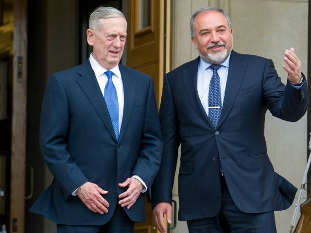 Defense Secretary Jim Mattis, left, welcomes Israeli Defense Minister Avigdor Lieberman to the Pentagon Tuesday, March 7, 2017. (AP Photo/Cliff Owen)