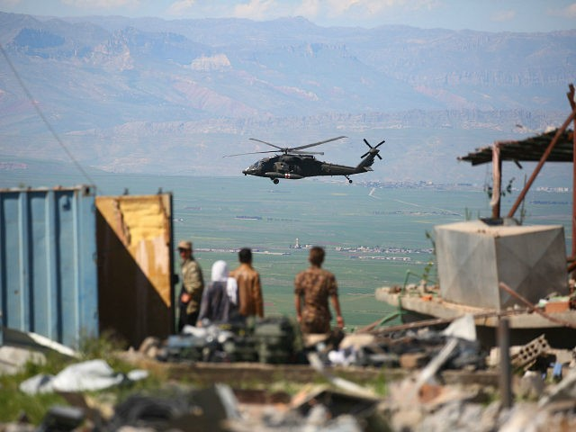 TOPSHOT - A medical helicopter, from the US-led coalition, flies over the site of Turkish airstrikes near northeastern Syrian Kurdish town of Derik, known as al-Malikiyah in Arabic, on April 25, 2017. Turkish warplanes killed more than 20 Kurdish fighters in strikes in Syria and Iraq, where the Kurds are …