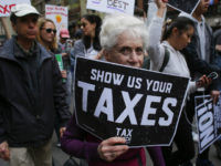 Protestors take part in the 'Tax March' calling on US President Donald Trump to release his tax records on April 15, 2017 in New York Thousands of protesters gathered Saturday, April 15, 2017 in cities across the United States to pressure President Donald Trump to release his tax returns, a move of transparency he has refused to make. The protests were timed to coincide with the traditional April 15 deadline for annual US tax filings. / AFP PHOTO / KENA BETANCUR (Photo credit should read KENA BETANCUR/AFP/Getty Images)