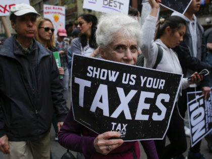 Protestors take part in the 'Tax March' calling on US President Donald Trump to release his tax records on April 15, 2017 in New York Thousands of protesters gathered Saturday, April 15, 2017 in cities across the United States to pressure President Donald Trump to release his tax returns, a …