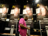 Be Ware, of Atlanta works on a vendor booth ahead of the NRA convention, Thursday, April 27, 2017, in Atlanta. The NRA is holding its 146th annual meetings and exhibits forum at the Georgia World Congress Center with President Donald Trump slated to speak Friday. (AP Photo/Mike Stewart)