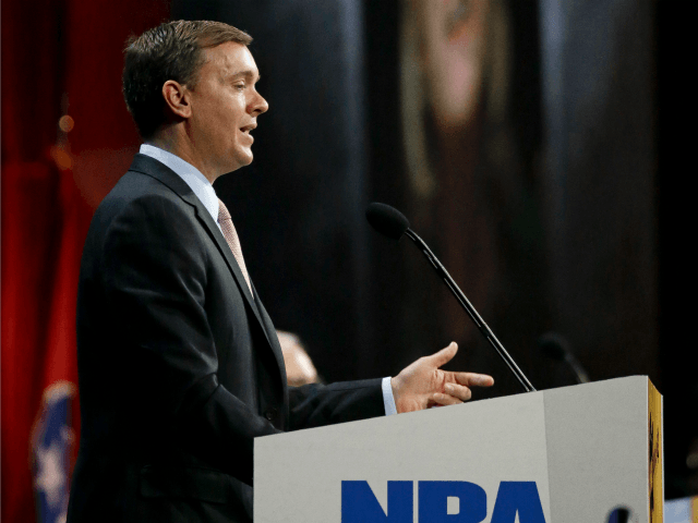 Chris Cox, executive director of the Institute for Legislative Action, the political and lobbying arm of the National Rifle Association, speaks during the annual meeting of members at the NRA convention Saturday, April 11, 2015, in Nashville, Tenn. Projected on a screen behind Cox is a picture of former Secretary …